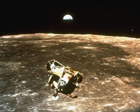 Nasa is the National Aeronautics and Space Administration - the photo shows its mission to the moon in 1969 with moon and earth in the background - earth the only home we have in this sol systems, visited by astronauts from NASA