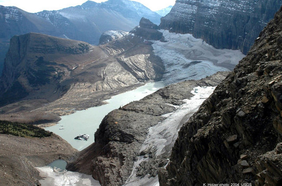 2004 photo of the Grinnell glacier. Look at the glacier how big it was and now, for a silent moment think about God think about his creation, men try to destroy
