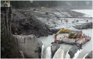 removal of a dam with heavy machinery