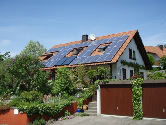 solar cells and solar water heating panels combined on a roof - the energy of the sun called solar energy will help us not to destroy Earth as we know it