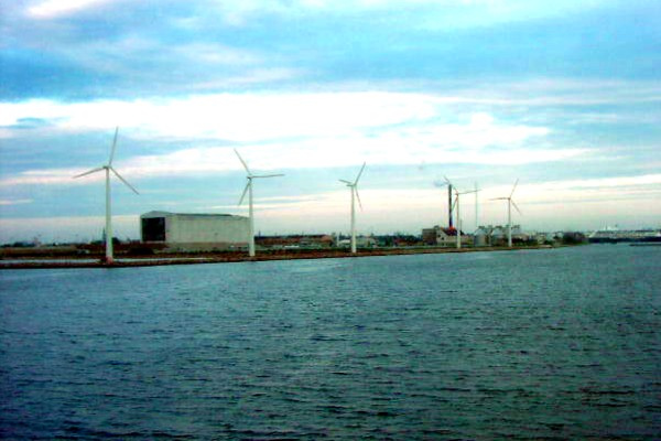 Household windmills, wind generators, wind farm in Helsinki are producing clean renewable energy for many households - show responsibility use renewable energy